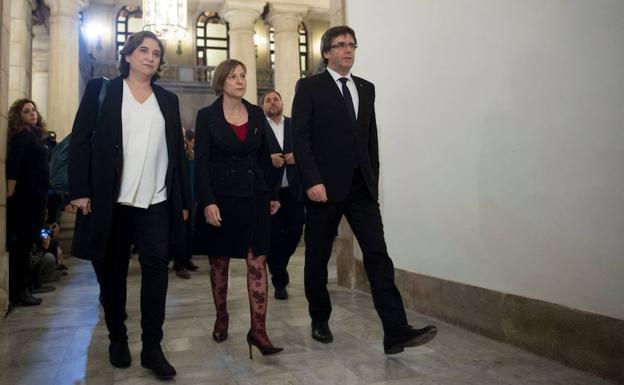 Ada Colau, Carme Forcadell y Carles Puigdemont.