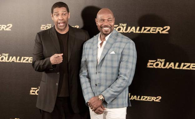 Denzel Washington y Antoine Fuqua, ayer, en Madrid. /E.P.
